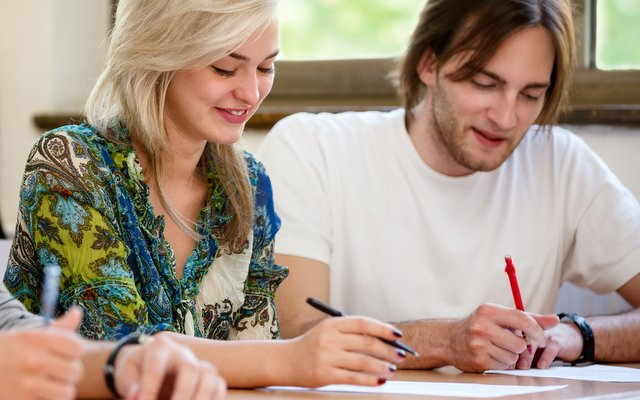 Students of English in an IELTS exam practice session